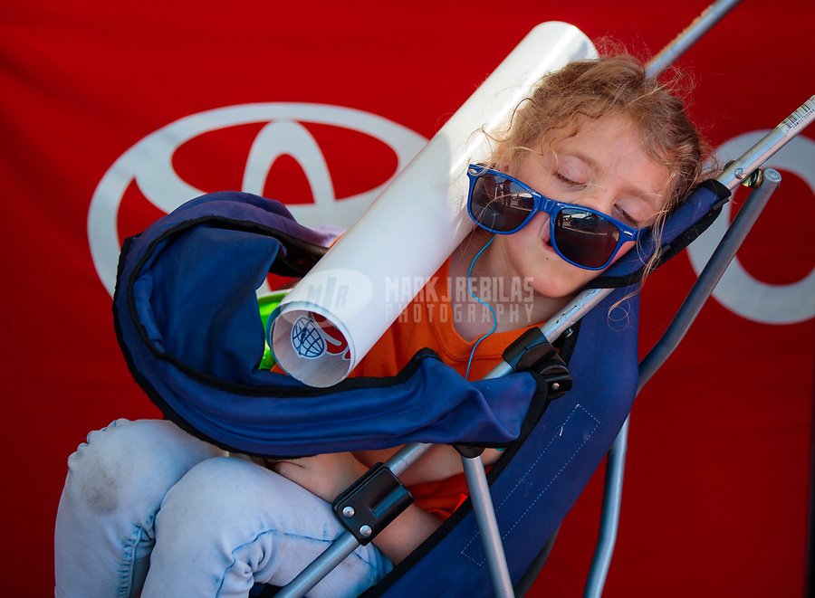 Mar 15, 2019; Gainesville, FL, USA; A young female fan sleeps during NHRA qualifying for the Gatornationals at Gainesville Raceway. Mandatory Credit: Mark J. Rebilas-USA TODAY Sports