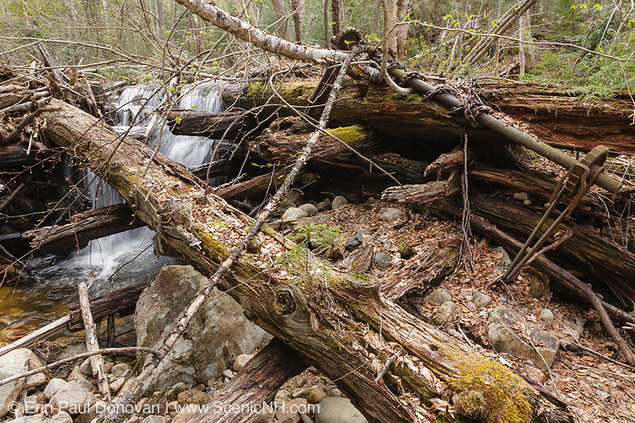 Mad River Logging Era - Remnants of a splash dam along Flume Brook near the old logging Camp 5 site in Waterville Valley, New Hampshire. Splash dams were used to hold back rushing water during spring melt. And when the gates were opened the strong flow of the brook would push four foot cut logs down the brook to the Mad River. From 1891-1946 +/- this area was logged, and up until 1933 log drives were done on the Mad River to move logs down to Campton Pond.