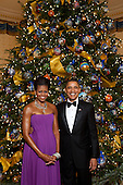 Washington, DC - December 6, 2009 -- United States President Barack Obama and First Lady Michelle Obama pose for a formal portrait in front of the official White House Christmas Tree in the Blue Room of the White House, Sunday, December 6, 2009.  .Mandatory Credit: Lawrence Jackson - White House via CNP
