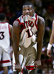"""THIS BITES""<br /> -On Sun Jan 12,2003<br /> -Despite being the game's high scorer at 20 points Rutgers # 11 Jerome Coleman bites his shirt out of frustration as Rutgers loses to Pittsburgh at the Louis Brown Athletic Center, Piscataway."