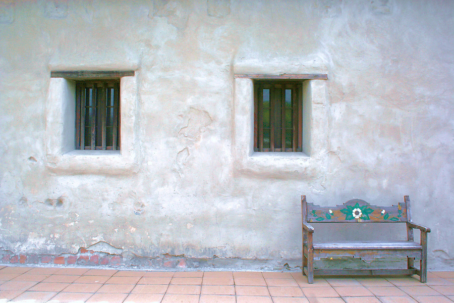Windows and painted bench at mission at San Juan Capistrano California