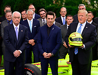 United States President Donald J. Trump, right, winning driver Simon Pagenaud, center, and Roger Penske, left, as the President greets the 103rd Indianapolis 500 Champions: Team Penske, on the South Lawn of the White House in Washington, DC on Monday, June 10, 2019.  The President took some questions on trade, Mexico, and tariffs against China.<br /> CAP/MPI/RS<br /> ©RS/MPI/Capital Pictures