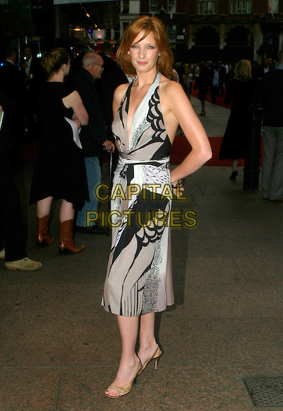 KELLY REILLY .Pride & Prejudice - UK film premiere, Odeon Leicester Square, London..September 5th, 2005.full length brown black pattern print dress halterneck.www.capitalpictures.com.sales@capitalpictures.com.© Capital Pictures.