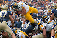 Iowa running back Mark Weisman (45) dives for a first down. Iowa Hawkeyes defeated the Pitt Panthers 24-20 at Heinz Field, Pittsburgh Pennsylvania on September 20, 2014.