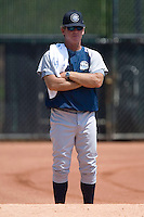 Columbus Clippers pitching coach Neil Allen watches as pitcher Steven White (not shown) warms up in the bullpen prior to taking on the Charlotte Knights at Knights Stadium in Fort Mill, SC, Tuesday, July 18, 2006.