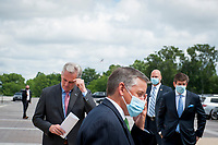 House Minority Leader Rep. Kevin McCarthy (R-Calif., center right) waits to hold a media availability with House Minority Whip Rep. Steve Scalise (R-LA), House GOP Conference Chairwoman Liz Cheney (R-WY) and others, to announce that Republican leaders have filed a lawsuit against House Speaker Nancy Pelosi and congressional officials in an effort to block the House of Representatives from using a proxy voting system to allow for remote voting during the coronavirus pandemic, outside of the U.S. Capitol in Washington, DC., Wednesday, May 27, 2020. Credit: Rod Lamkey / CNP/AdMedia