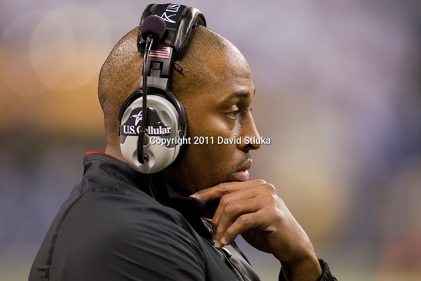 Wisconsin Badgers assistant coach DeMontie Cross looks on during the Big Ten Conference Championship NCAA college football game against the Michigan State Spartans on December 3 , 2011 in Indianapolis, Indiana. The Badgers won 42-39. (Photo by David Stluka)