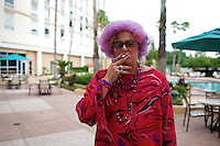 Dame Edna impersonator takes a cigarette break during the Sunburst Convention of Professional Tribute Artists