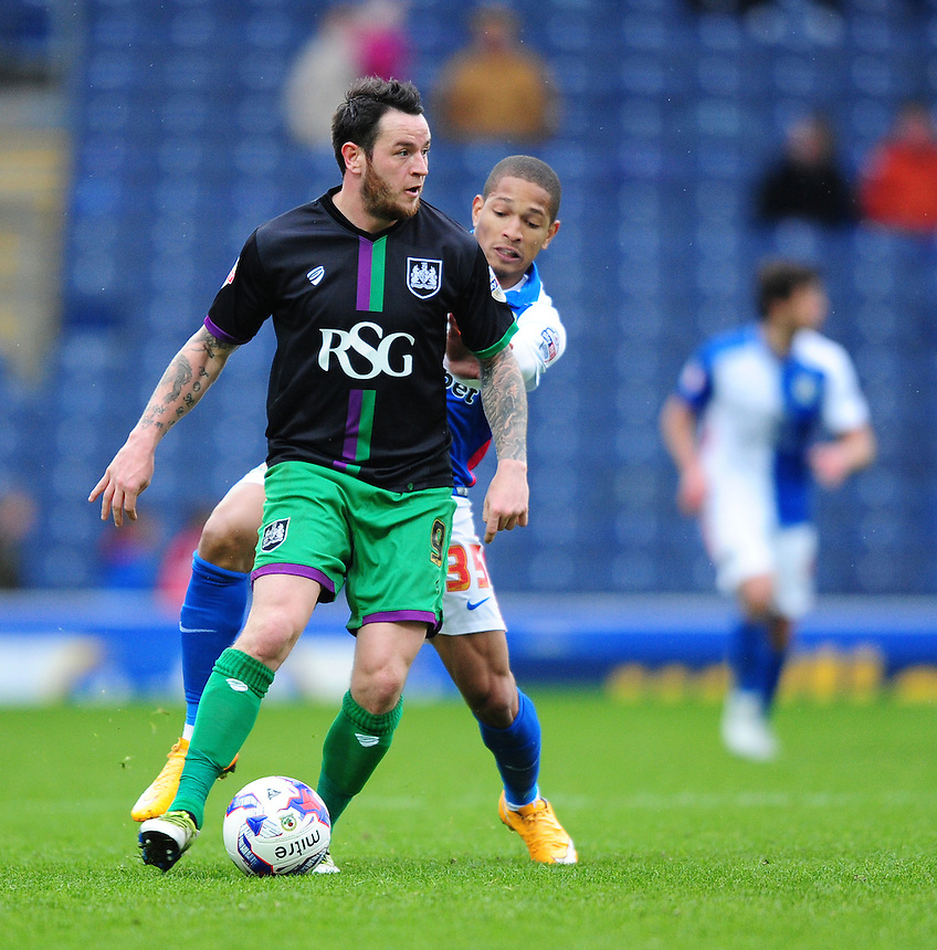 Bristol City&rsquo;s Lee Tomlin shields the ball from Blackburn Rovers&rsquo; Simeon Jackson<br /> <br /> Photographer Chris Vaughan/CameraSport<br /> <br /> Football - The Football League Sky Bet Championship - Blackburn Rovers v Bristol City - Saturday 23rd April 2016 - Ewood Park - Blackburn <br /> <br /> &copy; CameraSport - 43 Linden Ave. Countesthorpe. Leicester. England. LE8 5PG - Tel: +44 (0) 116 277 4147 - admin@camerasport.com - www.camerasport.com