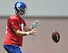 Eli Manning #10, New York Giants quarterback, takes a snap during training camp at Quest Diagnostics Training Center in East Rutherford, NJ on Friday, Aug. 3, 2018.