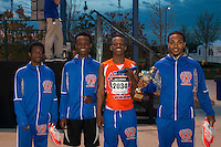 The East St. Louis High School boys sprint medley relay squad celebrates with their trophy after winning the event at the 2015 Kansas Relays.