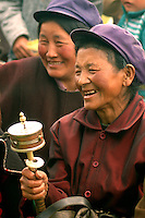 Lhoba women with prayer wheel in Nanyigeba Village in Mainling county. There are nearly a dozen ethnic minorities in Tibet. Primarily farmers, the Lhoba live in counties of southeastern Tibet and speak a distinctive language.