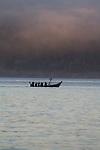 Canoe Journey, Paddle to Nisqually, 2016, Northwest tribal canoes paddling at sunrise, Salish Sea, Port Townsend, Olympic Peninsula, Puget Sound, Washington State, USA, tradition, history, tribal gatherings, Indian, canoes,