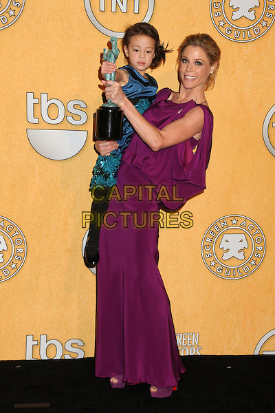 Aubrey Anderson-Emmons & Julie Bowen.The 18th Annual Screen Actors Guild Awards held at The Shrine Auditorium in Los Angeles, California, USA..January 29th, 2012.SAG SAGS full length pink purple fuschia kid child carrying holding award trophy winner side  .CAP/ADM/BP.©Byron Purvis/AdMedia/Capital Pictures.