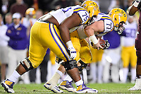 LSU center Ethan Pocic (77) recovers a fumble as a result of Texas A&M defensive lineman Myles Garrett (15) pass rush on quarterback Anthony Jennings (10) during an NCAA football game, Thursday, November 27, 2014 in College Station, Tex. LSU defeated Texas A&M 23-17. (Mo Khursheed/TFV Media via AP Images)