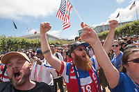 "San Francisco, CA - Thursday, June 26, 2014:  USA soccer fans (left to right) ""Uncle Bob,"" Shadow Moyer and Cara Sallee of Alameda celebrate the USA advancing to the second round after watching the USA vs. Germany first round World Cup match at a public viewing at the Civic Center in San Francisco, CA"