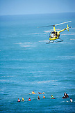 USA, Hawaii, Oahu, helicopter above surfers in the ocean at Waimea bay