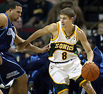 Seattle SuperSonics' Luke Ridnour drives against  Utah Jazz' Deron Williams in NBA basketball action in the period Friday, Nov. 17, 2006 in Seattle.  Jim Bryant Photo. ©2010. All Rights Reserved.