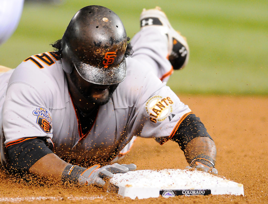 15 SEPTEMBER 2011: San Francisco Giants third baseman Pablo Sandoval (48) slides headfirst and stretches a triple on his way to hitting for the cycle during a regular season game between the San Francisco Giants and the Colorado Rockies at Coors Field in Denver, Colorado. The Giants beat the Rockies 8-5. *****For Editorial Use Only*****