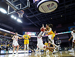 SIOUX FALLS, SD - MARCH 8: Sofija Zivaljevic #4 of the North Dakota State Bison drives to the basket against Denver Pioneers defender at the 2020 Summit League Basketball Championship in Sioux Falls, SD. (Photo by Richard Carlson/Inertia)