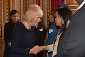 London, Uk. 15/10/2015. HRH The Duchess of Cornwall is introduced to the parents of Martina Watler, the Junior Runner-up. The Duchess of Cornwall on behalf of Her Majesty The Queen, Patron of The Royal Commonwealth Society, holds a reception for winners of The Queen's Commonwealth Essay Competition at Buckingham Palace. The Queen's Commonwealth Essay Competition was founded in 1883 and is the world's oldest international schools' writing contest. This year's competition, sponsored by Cambridge University Press, received more than 13,000 entries from over 600 schools in 49 Commonwealth countries and territories. The Duchess of Cornwall hands out awards to young writers who have travelled from across the Commonwealth to attend the reception. This year's winners have come from Cyprus, Botswana, The Cayman Islands and as far away as Tristan da Cunha - over 9000km away.