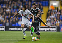 Maksim Medvedev  of Qarabag FK attempts to tackle Erik Lamela of Tottenham Hotspur during the UEFA Europa League match between Tottenham Hotspur and Qarabag FK at White Hart Lane, London, England on 17 September 2015. Photo by Andy Rowland.
