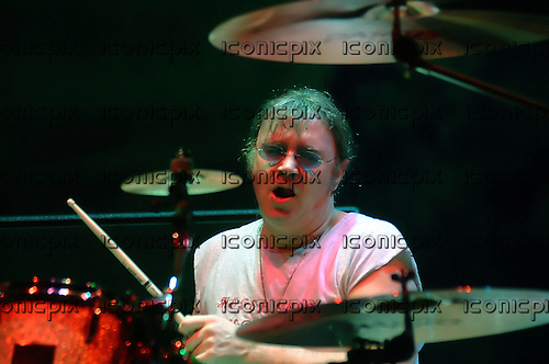 Deep Purple - drummer Ian Paice - performing live at the Apollo Hammersmith in London UK - 22 Feb 2002.  Photo credit: George Chin/IconicPIx