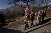 A parade of bachelors at Carnival visit neighbors during Carnival in the small village of Dreznica, Slovenia (population 65).  The men dress in costume and rap on every door in town. Neighbors invite them in to eat and drink in celebration. The people of old Europe thought that evil caused the dark and cold winter. When spring arrived, they came out to rejoice that light wins over darkness, and to begin another year.