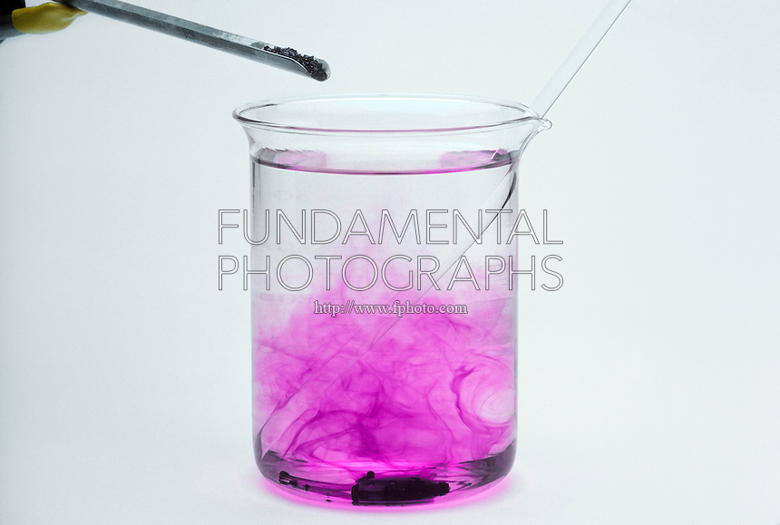 POTASSIUM PERMANGANATE DISSOLVES IN WATER<br /> KmNO4 Added to H2O<br /> Potassium permanganate (KmNO4) is added to water.