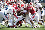 Wisconsin Badgers linebackers Chris Orr (54), Andrew Van Ginkel (17) and T.J. Edwards (53) tackle Florida Atlantic Owls running back Devin Singletary (5) during an NCAA College Football game Saturday, September 9, 2017, in Madison, Wis. The Badgers won 31-14. (Photo by David Stluka)