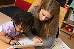 Education preschool 3-4 year olds SEIT working with girl in classroom