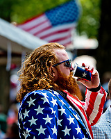 SARATOGA SPRINGS, NY - AUGUST 26: A fan in a patriotic themed jacket drinks a beer on Travers Stakes Day at Saratoga Race Course on August 26, 2017 in Saratoga Springs, New York. (Photo by Scott Serio/Eclipse Sportswire/Getty Images)