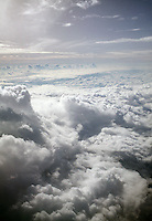 CLOUDS: VIEW FROM AIRPLANE<br /> Swelling cumulus &amp; altocumulus