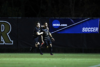 WINSTON-SALEM, NC - NOVEMBER 24: Bruno Lapa #10 of Wake Forest University celebrates his goal with Isaiah Parente #15 during a game between Maryland and Wake Forest at W. Dennie Spry Stadium on November 24, 2019 in Winston-Salem, North Carolina.