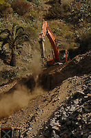 Mechanical digger used to widen road in La Gomera, Canary Islands,Spain.