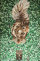 A playful mosaic squirrel in one of the en-suite bathrooms