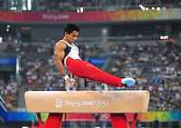 Aug. 9, 2008; Beijing, CHINA; Raj Bhavsar (USA) performs on the pommel horse during mens gymnastics qualification during the Olympics at the National Indoor Stadium. Mandatory Credit: Mark J. Rebilas-