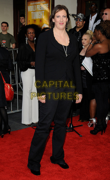 MIRANDA HART.The World Premiere of 'The Infidel' at the Hammersmith Apollo, London, England, UK..April 8th, 2010.arrivals full length black jacket trousers.CAP/CAN.©Can Nguyen/Capital Pictures.