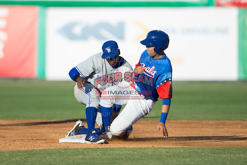 Emmanuel Rivera (24) of the Burlington Royals is tagged out at second base by Bluefield Blue Jays shortstop Jesus Severino (33) at Burlington Athletic Stadium on June 26, 2016 in Burlington, North Carolina.  The Blue Jays defeated the Royals 4-3.  (Brian Westerholt/Four Seam Images)