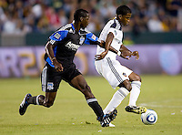 LA Galaxy forward Edson Buddle (14) is chased down by San Jose Earthquakes defender Ike Opara (6). The LA Galaxy and the San Jose Earthquakes played to a 2-2 draw at Home Depot Center stadium in Carson, California on Thursday July 22, 2010.