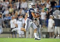 Sept. 19, 2009; Provo, UT, USA; BYU Cougars running back (10) J.J. Di Luigi runs for a touchdown against the Florida State Seminoles at LaVell Edwards Stadium. Florida State defeated BYU 54-28. Mandatory Credit: Mark J. Rebilas-
