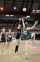 JOHANNESBURG, SOUTH AFRICA - JANUARY 25: Maria Folau of the Silver Ferns shoots for goal with Karla Pretorius of the SPAR Proteas  during the Netball Quad Series netball match between Spar Proteas and Silver Ferns at the Ellis Park Arena in Johannesburg. Mandatory Photo Credit: ©Reg Caldecott/Michael Bradley Photography