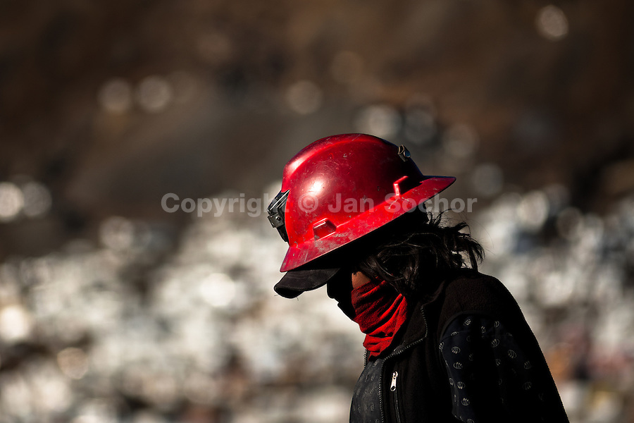 Pallaquera, a female gold miner, walks close to the gold mines in La Rinconada, Peru, 4 August 2012. During the last decade, the rising price of the gold has attracted thousands of people to La Rinconada in the Peruvian Andes. At 5300 metres above sea level, nearly 50.000 people work in the gold mines and live in the nearby colonies without running water, sewage system or heating service. Although the work in the mines is very dangerous (falling rocks, poisonous gases and a shifting glacier), the majority of miners have no contract and operate under the cachorreo system - working 30 days without payment and taking the gold they supposedly find the 31st day as the only salary. In spite of a demaged environment, caused by mercury contamination from the mining and the lack of garbage disposal, people continue to flock to the region hoping to find their fortune.