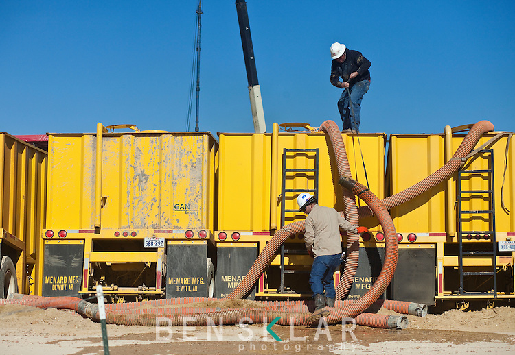 Contractors check water levels for fracking  on a Goodrich Oil Co field  on the Burns Ranch near Dilley, Texas on Tuesday, January 3, 2012...Ben Sklar