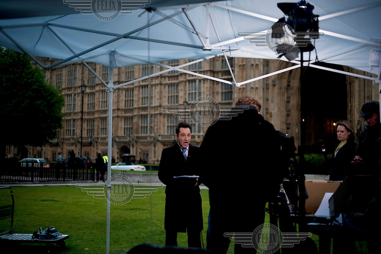 Jonathan Charles for BBC World News broadcasts live on television from College Green, Westminster, London, in the uncertain days after an inconclusive general election result.