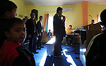 ROMa men sing religious songs in Romanian language adapted by gypsy music and lyrics during a  Sunday service at the Pentecostal church in Barbulesti, Romania. 15 years ago, the population of Barbulesti, a village situated in the south of Romania and inhabited mostly by ROMa people, started to convert to the Pentecostal Church. Believers say that conversion led to a decrease in crime in the area, although official statistics do not confirm it.