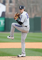 RHP Luke Farrell (52) of the Northwestern Wildcats pitches in a game against the Furman University Paladins on Saturday, February 16, 2013, at Fluor Field in Greenville, South Carolina. The game was cancelled in the fifth inning due to snow. Farrell was named to the 2013 Big Ten Players to Watch list. (Tom Priddy/Four Seam Images)