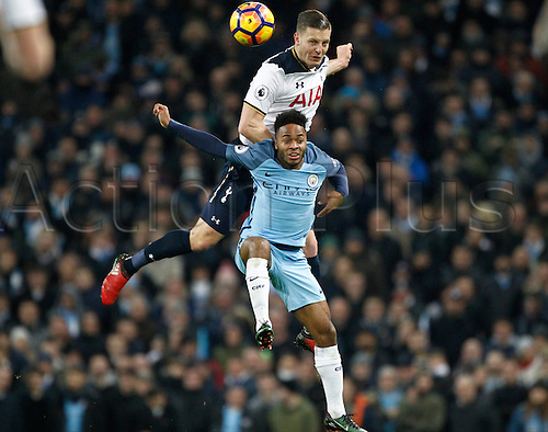 21st January 2017, Etihad Stadium, Manchester, Lancashire, England; EPL Premiership football Manchester City versus Tottenham Hotspur;  Kevin Wimmer of Tottenham Hotspur wins an aerial duel against Raheem Sterling of Manchester City