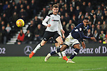 Mahlon Romeo of Millwall clears the ball as he is chased down by Sam Winnall of Derby County during the championship league match between Derby and Millwall at Pride Park Stadium, Derby. Picture date 23rd December 2017. Picture credit should read: Joe Perch/Sportimage