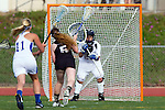 Torrance, CA 05/09/13 - Ellie Strauch (Oak Park #5) and Issi Sherren (Agoura #27) in action during the 2013 Los Angeles area Girls Varsity Lacrosse Championship.  Agoura defeated Oak Park 13-7.